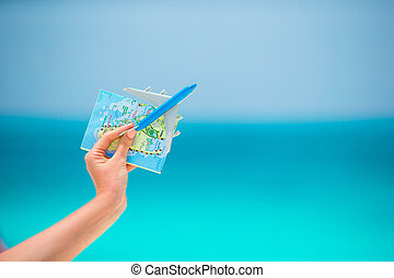 Closeup of map and toy airplane background the sea