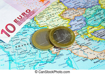 closeup of map of Europe and Euro coins