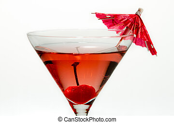 Closeup of martini red cocktail with an umbrella