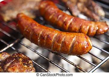 Closeup of meat on grill - Barbecue a hot summer evening,...