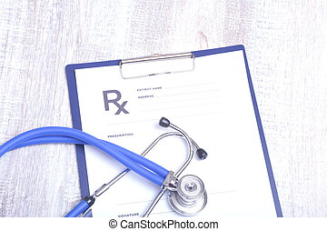Closeup of medical stethoscope on a rx prescription