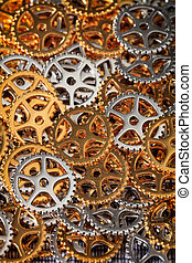 Closeup of metallic cogwheels pile