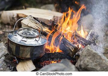 Closeup Of Metallic Pot On Bonfire - Closeup of metallic pot...