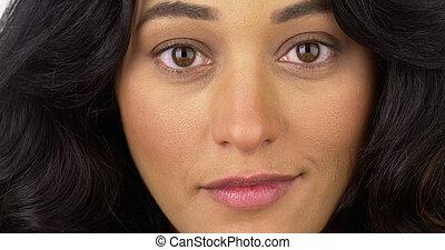 Closeup of Mexican woman looking at camera