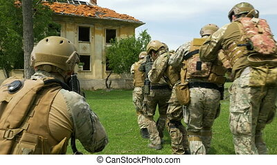 Closeup of military armed soldiers during training...