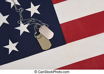 Closeup of military dog tags on American Flag