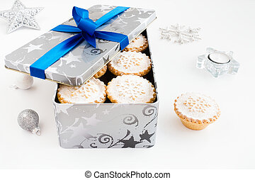 Closeup of Mince Pies in Cookie Tin with Christmas Decoration