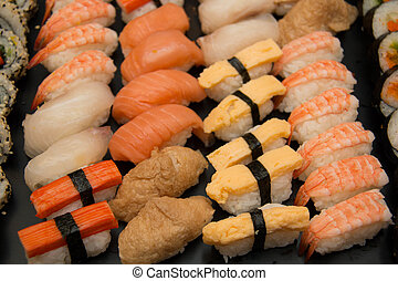 mixed sushi rolls on a plate