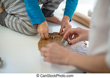 Closeup of mother and toddler child making cookies