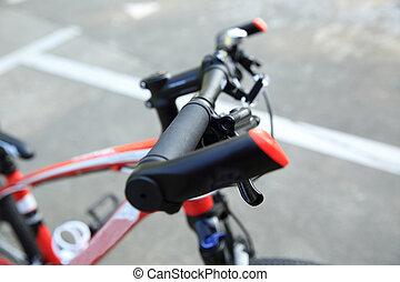closeup of mountain bike at parking lot