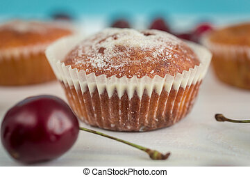 Closeup of muffin with fresh cherry
