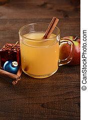 mug of apple cider with cinnamon stick