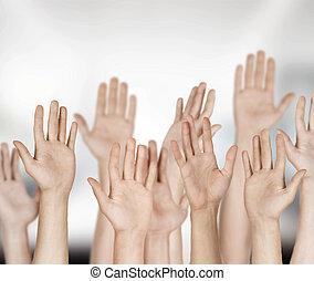 Closeup of multiethnic men and women raising hands