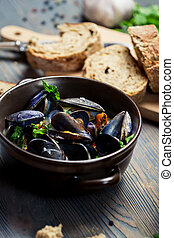 Closeup of Mussels served with bread