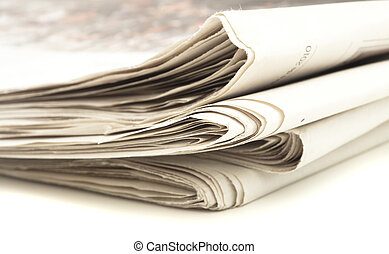 newspaper - closeup of newspaper on a white background