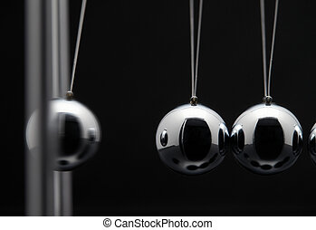 Closeup Of Newton Balls With Swinging Metal Spheres -...
