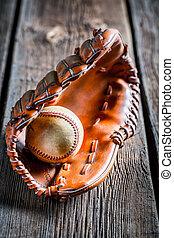 Closeup of old baseball glove and ball