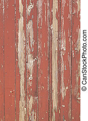 closeup of old brown red planks with peeling paint