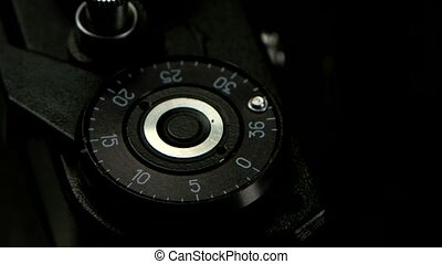 Closeup of old cameras shutter button and girl pressing it,...