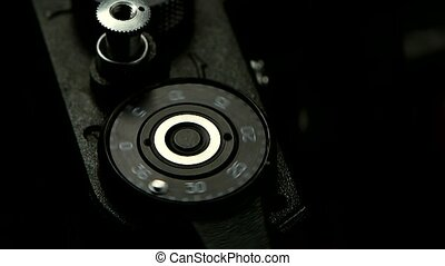 Closeup of old cameras shutter button, pressing in slow...