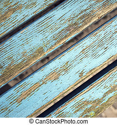 grungy bench planks with peeling blue paint