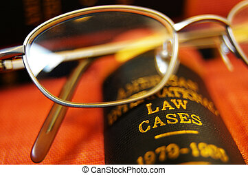 Closeup of open law book and glasses