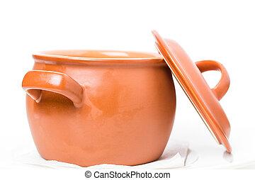 Closeup of orange clay pot.