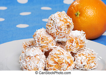 closeup of orange snowball cookies