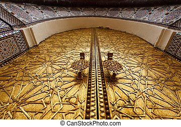 Closeup of ornate carved brass door of palace in Fez, Morocco