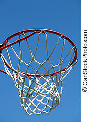 closeup of outdoor basketball hoop against blue sky
