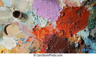Closeup of Paints on Palette - Artist trying paints on...