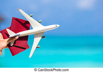 Closeup of passports and white airplane background the sea