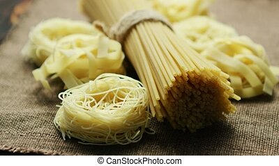 Closeup of pasta and spaghetti - Closeup shot of uncooked...