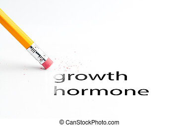 Closeup of pencil eraser and black growth hormone text. Growth hormone. Pencil with eraser. Gh.