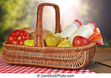 Picnic Basket With Food And Drink On The Table
