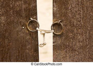 knocker on the iron gate