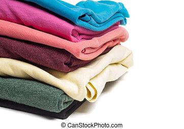 Closeup of pile of folded T shirts