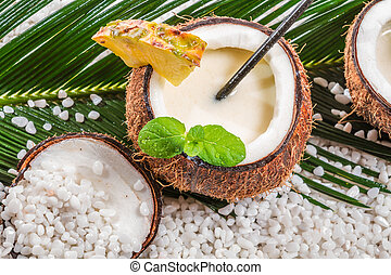Closeup of pinacolada drink served in a coconut
