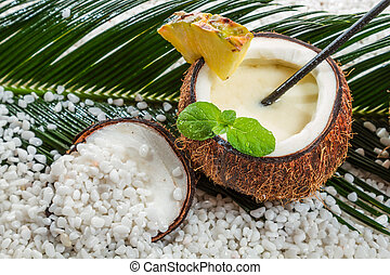 Closeup of pinacolada in a coconut