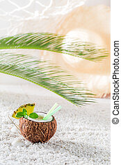 Closeup of pinacolada in coconut in sunny day