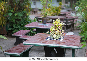 Closeup of plant pot on table in garden