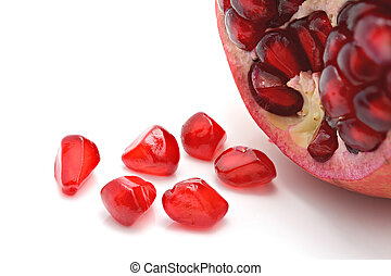 Closeup of pomegranate Seeds on white