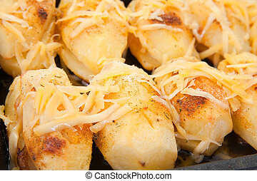 Closeup of potatoes with cheese