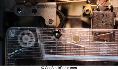 pulling tape mechanism - closeup of pulling tape mechanism...