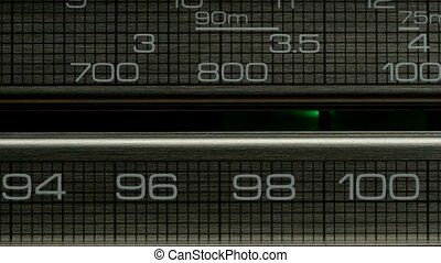 Closeup of radio receiver is looking for wave on stations -...