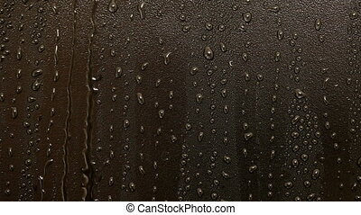 closeup of raindrops on black