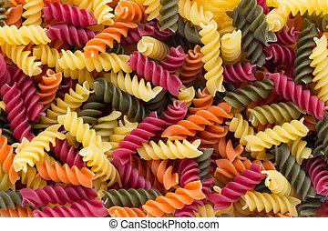 Closeup of raw eco macaroni pasta background. - Eco macaroni...