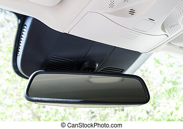 Closeup of rear view mirror in modern car interior