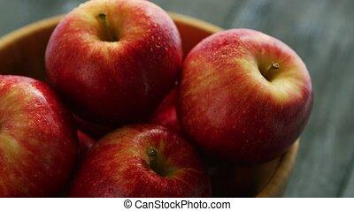 Closeup of red apples in bowl - Closeup shot of bowl filled...