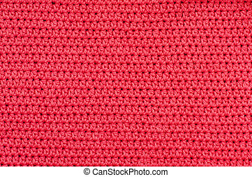 Closeup of red crochet fabric